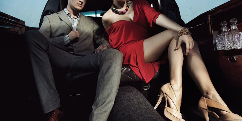 Beautiful couple sitting in a limousine